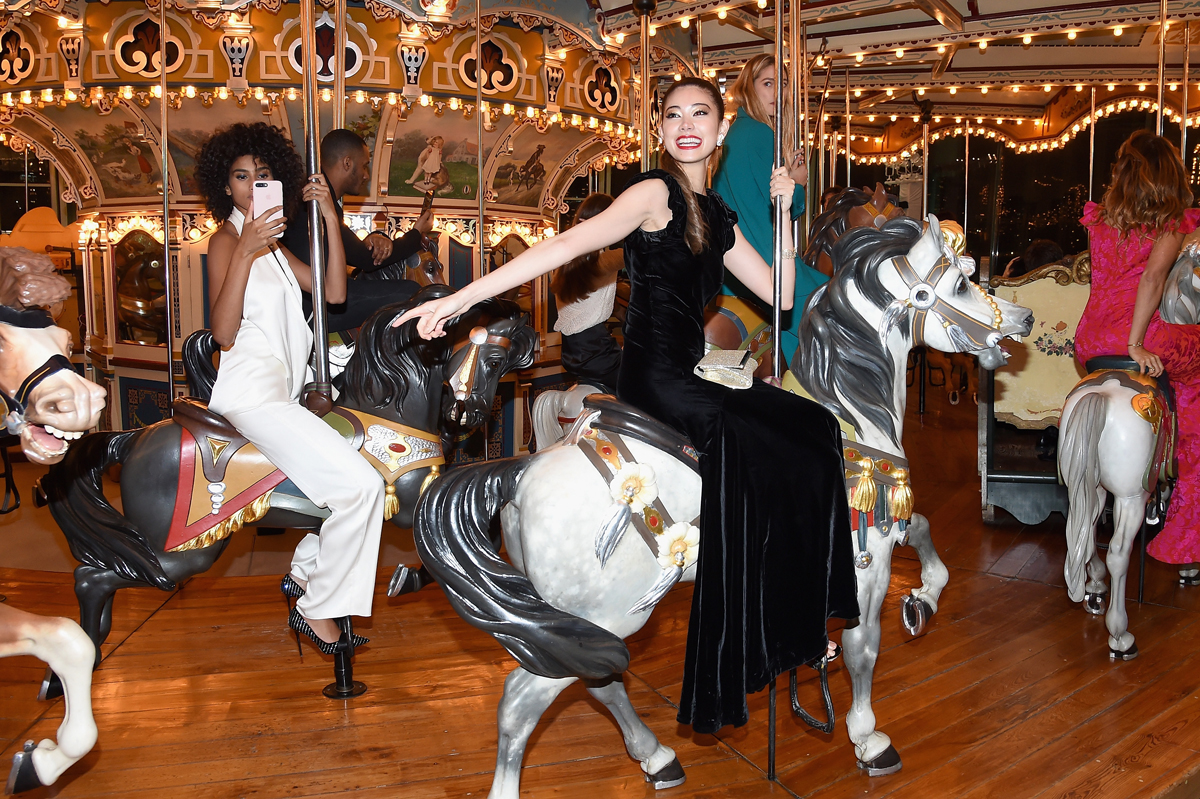 NEW YORK, NY - APRIL 21:  Imaan Hammam and Hikari Mori ride a carousel at the Tiffany & Co. 2017 Blue Book Collection Gala at ST. Ann's Warehouse on April 21, 2017 in New York City.  (Photo by Nicholas Hunt/Getty Images for Tiffany & Co.)