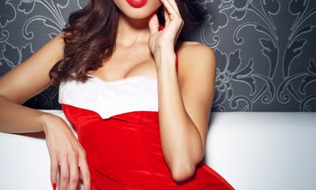 Santa woman with red lips and nails